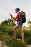 Teenager traveler with backpacks climbs the mountain. Wanderlust travel concept Stock Image
