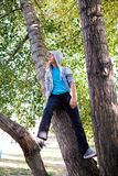Teenager on the Tree royalty free stock photos
