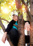Teenager on the Tree royalty free stock image