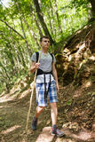 Teenager trekking into the forest Stock Images