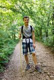 Teenager trekking into the forest Royalty Free Stock Photography