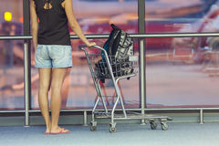 Teenager with trolley in airport Royalty Free Stock Images