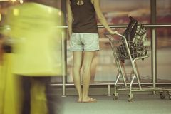 Teenager with trolley in airport Stock Photo