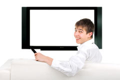 Teenager and tv-set. Cheerful teenager sitting on the sofa and watching tv-set Royalty Free Stock Image
