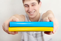 Teenager with Two Books Stock Photos