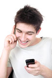 Teenager with two phones Stock Image