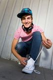 Teenager Tying Shoes Royalty Free Stock Photos