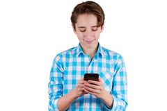Teenager is typing a message in phone Stock Photography