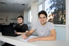 Teenager university students working on school classroom with la Royalty Free Stock Photography