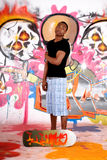 Teenager urban graffiti. African American teenager in front of graffiti wall, urban setting.  Studio shoot Royalty Free Stock Photo