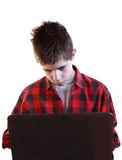 Teenager using laptop Stock Images