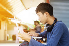 Teenager using laptop Royalty Free Stock Photo