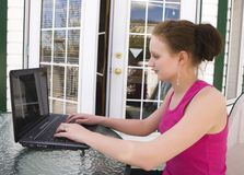 Teenager using laptop at home Royalty Free Stock Photo
