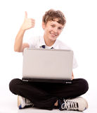 Teenager using laptop - thumb up. Attractive teen  Boy with Laptop Computer giving  thumb up  on white background Royalty Free Stock Image