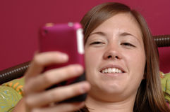 Teenager using mobile phone Stock Photos