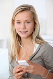 Teenager using mobile phone Stock Image