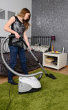 Teenager with vacuum cleaner Royalty Free Stock Photography