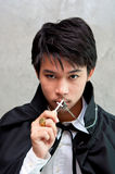 A teenager vampire holds cross Stock Photography