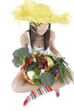 Teenager with vegetable. Teenager hold a basket of full vegetables before a white background Stock Photos