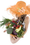 Teenager with vegetable. Teenager hold a basket of full vegetables before a white background Royalty Free Stock Images