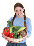 Teenager with vegetables Stock Images