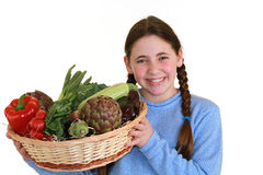 Teenager with vegetables Royalty Free Stock Photos