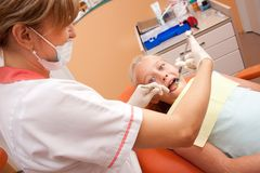 Teenager visiting dentist royalty free stock photography