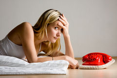 Teenager waiting by phone royalty free stock photo