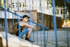 Teenager walk with backpack. Hip hop teenager walk on street Stock Photos