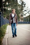 Teenager on walk in city Stock Image