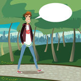 Teenager walking at city park Royalty Free Stock Photo