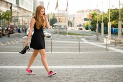 Teenager walking down street Royalty Free Stock Photo