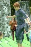 Teenager walking on an inflatable Stonhenge Royalty Free Stock Image