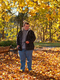 Teenager walking in park in fall Stock Image