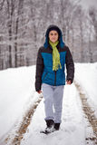 Teenager walking trough the forest on wintertime Royalty Free Stock Images