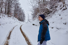 Teenager walking on wintertime Royalty Free Stock Photography