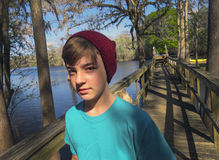 Teenager Walks the Dock Bridge - Ellie Rays RV Resort Royalty Free Stock Photography