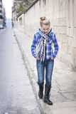 A teenager wandering the streets, hands in her pockets Royalty Free Stock Image