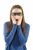 Teenager watching a 3D movie with 3D glasses Royalty Free Stock Photo