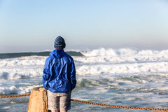 Teenager Watching Ocean Waves Stock Photo