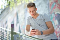 Teenager watching video on his mobile phone Royalty Free Stock Photo