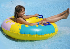 Teenager in water attraction. Pretty teenager swimming wild river in water park Stock Photo