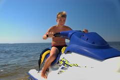 Teenager on water bick. Royalty Free Stock Photo