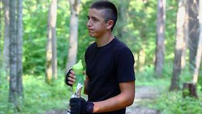Teenager with water bottle and walking sticks stock footage
