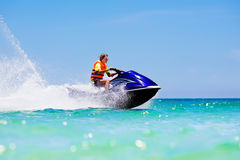 Teenager on water scooter. Teen age boy water skiing. Royalty Free Stock Photos