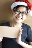 Teenager wear santa hat showing blank board Stock Image