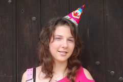 Teenager wearing party hat Stock Photography