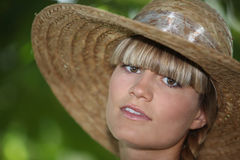 Teenager wearing straw hat Stock Photo