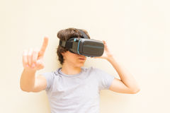 Teenager wearing VR glasses Stock Photos