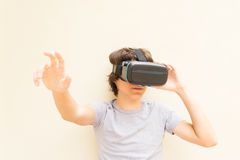 Teenager wearing VR glasses Stock Photography